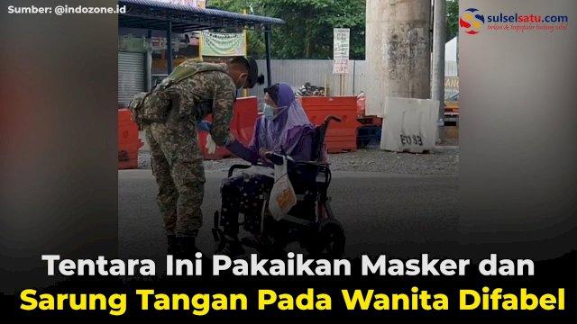 VIDEO: Tentara Ini Pakaikan Masker dan Sarung Tangan Pada Wanita Difabel