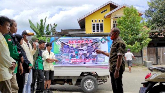 Relawan FSEI UNIKA Serahkan Bantuan 50 Paket Sembako Korban Banjir dan Longsor di Mamuju